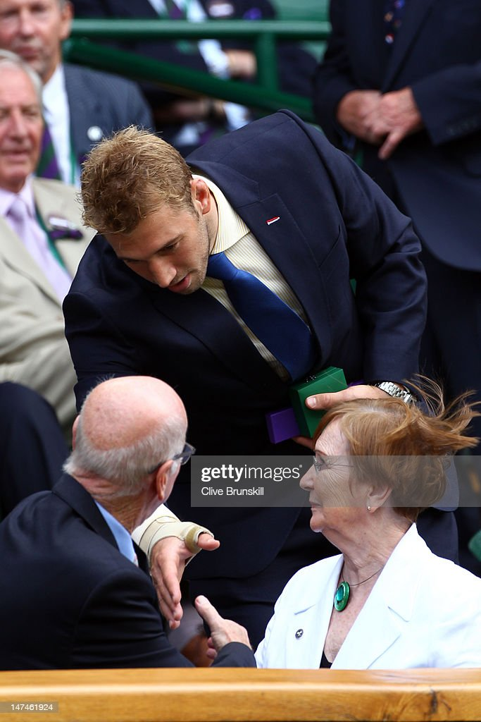 Former football player Sir Bobby Charlton and Rugby player Chris Robshaw attend the Ladies' Singles third round match Serena Williams of the USA and Jie Zheng of China on day six of the Wimbledon Lawn Tennis Championships at the All England Lawn Tennis and Croquet Club at Wimbledon on June 30, 2012 in London, England.