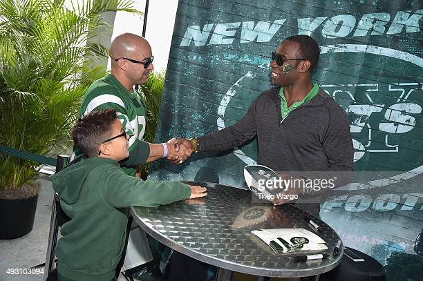 Former football player Tony Richardson greets fans during Jets Chefs The Ultimate Tailgate hosted by Joe Namath and Mario Batali Food Network Cooking...