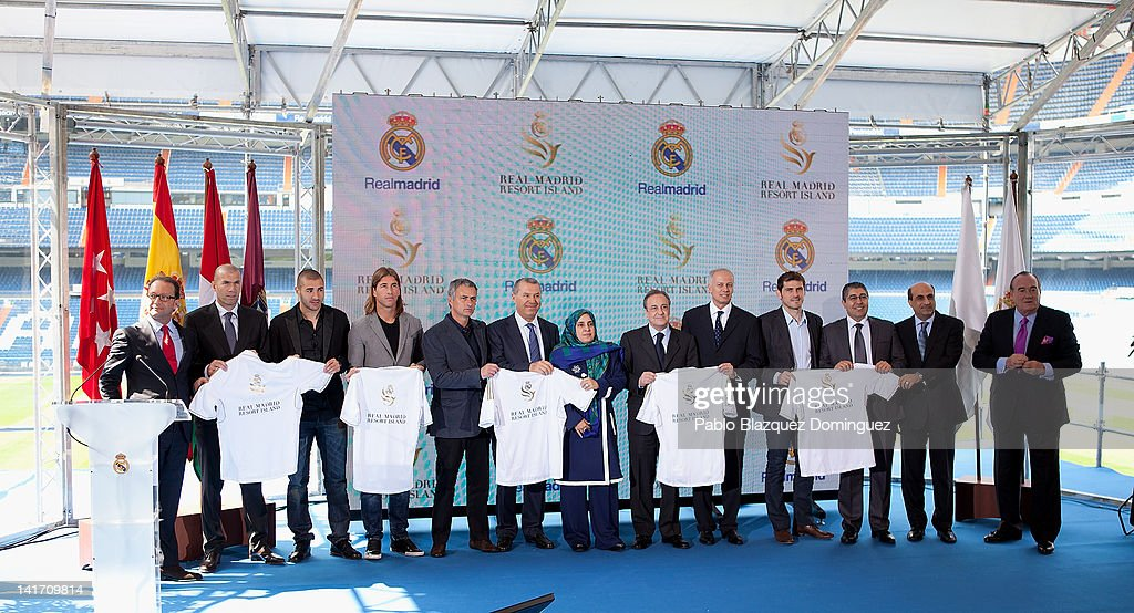 Former football player <a gi-track='captionPersonalityLinkClicked' href=/galleries/search?phrase=Zinedine+Zidane&family=editorial&specificpeople=172012 ng-click='$event.stopPropagation()'>Zinedine Zidane</a>, Real Madrid players <a gi-track='captionPersonalityLinkClicked' href=/galleries/search?phrase=Karim+Benzema&family=editorial&specificpeople=796089 ng-click='$event.stopPropagation()'>Karim Benzema</a>, Sergio Ramos, coach Jose Mourinho, Representative of the government of the United Arab Emirates, Khater Massaad, United Arab Emirates ambassador Hissa Abdulla Ahmed Al-Otaiba, Real Madrid's President <a gi-track='captionPersonalityLinkClicked' href=/galleries/search?phrase=Florentino+Perez&family=editorial&specificpeople=567584 ng-click='$event.stopPropagation()'>Florentino Perez</a> and Louis Armand de Rouge, CEO of RAK Investments and Real Madrid goalkeeper <a gi-track='captionPersonalityLinkClicked' href=/galleries/search?phrase=Iker+Casillas&family=editorial&specificpeople=215446 ng-click='$event.stopPropagation()'>Iker Casillas</a> pose for photographers during the Real Madrid Resort Island presentation at Estadio Santiago Bernabeu on March 22, 2012 in Madrid, Spain.