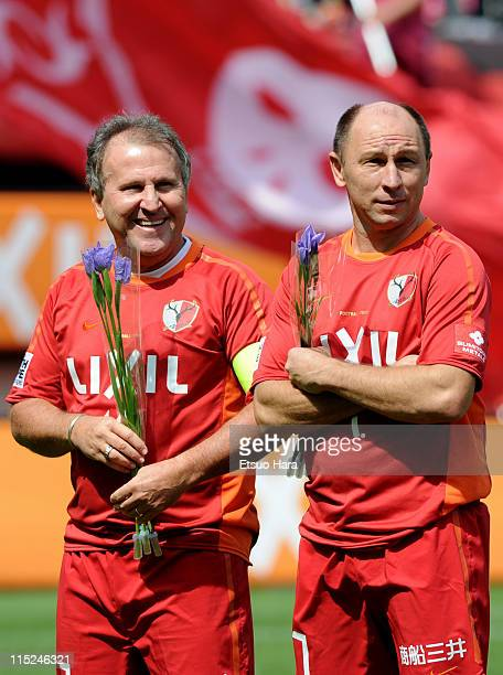 Former football players Zico and Alcindo Sartori pose for photographs during the 'Smile Again Yell From Kashima' charity match at Kashima Stadium on...