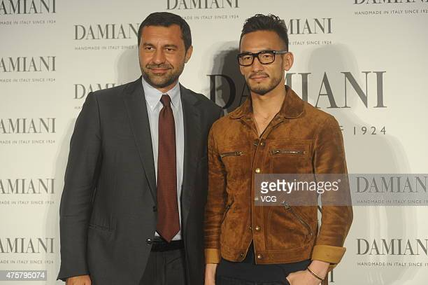 Former football star Nakata Hidetoshi of Japan pose with Giorgio Damiani the third generation of Damiani jewelry during the press conference of...