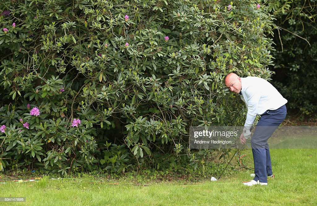 Former footballer <a gi-track='captionPersonalityLinkClicked' href=/galleries/search?phrase=Alan+Shearer&family=editorial&specificpeople=157676 ng-click='$event.stopPropagation()'>Alan Shearer</a> plays out of the bushes during the Pro-Am prior to the BMW PGA Championship at Wentworth on May 25, 2016 in Virginia Water, England.