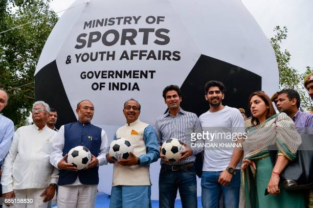 Former footballer and Chief Minister of Manipur Nongthombam Biren Singh Minister of Youth Affairs and Sports Vijay Goel Indian cricketer Mohammad...
