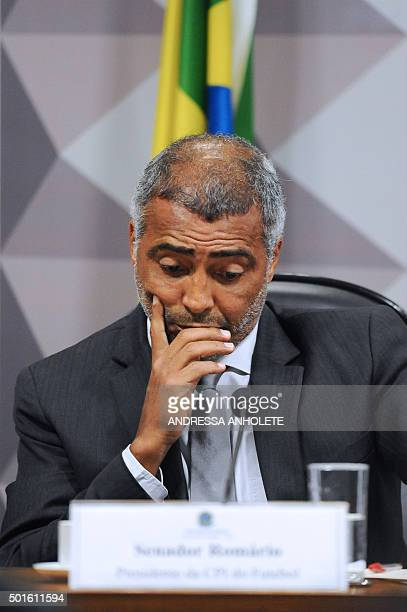 Former footballer and current senator Romario listens to Marco Polo Del Nero president on leave of the Brazilian Football Confederation during a...