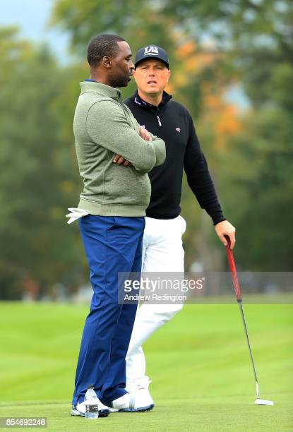 Former footballer Andy Cole and Graeme Storm of England speak during the pro am ahead of the British Masters at Close House Golf Club on September 27...