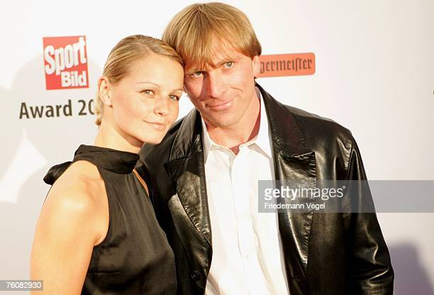 Former footballer Ansgar Brinkmann and his wife attend the Sport Bild Award 2007 at the Elb Lounge on August 13 2007 in Hamburg Germany