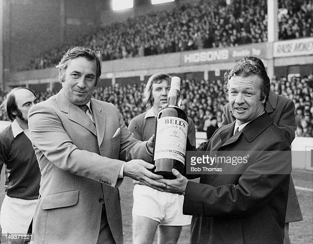 Former footballer Billy Bingham the manager of Everton FC and current Manager of the Month is awarded a giant bottle of Bell's whisky during a match...