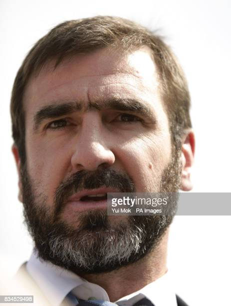 Former footballer Eric Cantona sits on a throne during a photocall to unveil his latest role as the 'King of England' in Trafalgar Square central...