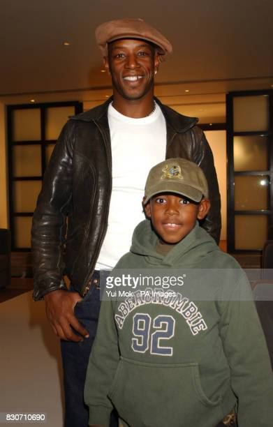 Former footballer Ian Wright and his son Stacey at bespoke tailor Mark Powell's launch of his new collection for the S/S 2002 at Sartoria