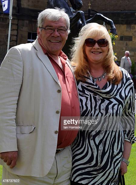 Former footballer Malcolm Macdonald with wife Carol during The Northumberland Plate Meeting at High Gosforth Park on June 27 2015 in Newcastle England