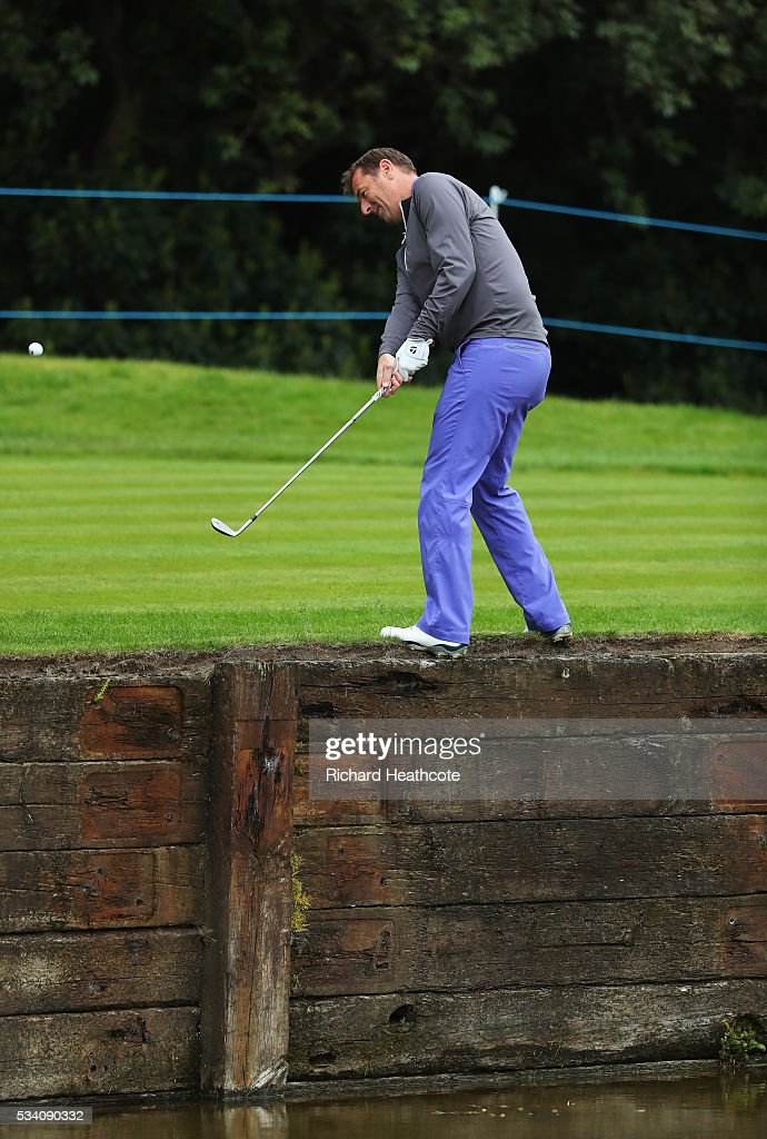 Former footballer Matt Le Tissier plays out of trouble during the Pro-Am prior to the BMW PGA Championship at Wentworth on May 25, 2016 in Virginia Water, England.