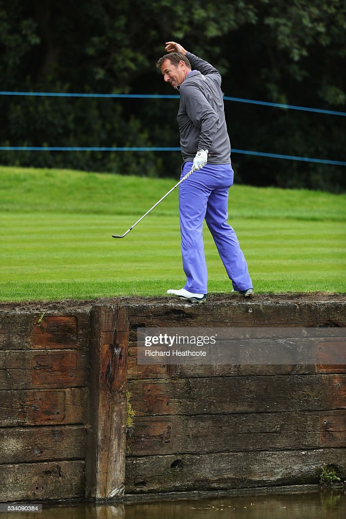 Former footballer Matt Le Tissier plays out of trouble on the 18th hole during the Pro-Am prior to the BMW PGA Championship at Wentworth on May 25, 2016 in Virginia Water, England.