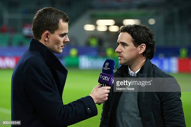 Former footballer Owen Hargreaves is interviewed prior to kickoff during the UEFA Champions League group B match between VfL Wolfsburg and Manchester...