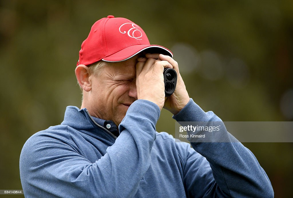 Former footballer <a gi-track='captionPersonalityLinkClicked' href=/galleries/search?phrase=Peter+Schmeichel&family=editorial&specificpeople=460152 ng-click='$event.stopPropagation()'>Peter Schmeichel</a> checks the yardage during the Pro-Am prior to the BMW PGA Championship at Wentworth on May 25, 2016 in Virginia Water, England.