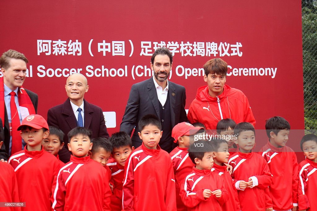 Former footballer <a gi-track='captionPersonalityLinkClicked' href=/galleries/search?phrase=Robert+Pires&family=editorial&specificpeople=167225 ng-click='$event.stopPropagation()'>Robert Pires</a> attends Arsenal Soccer School opening ceremony at Hongkou Stadium on November 29, 2015 in Shanghai, China.