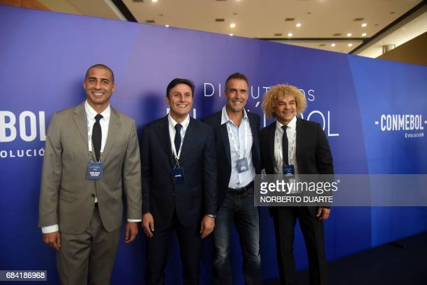Former footballers David Trezeguet Javier Zanetti Gabriel Bastituta and Carlos Valderrama pose upon their arrival at the Conmebol headquarters in...