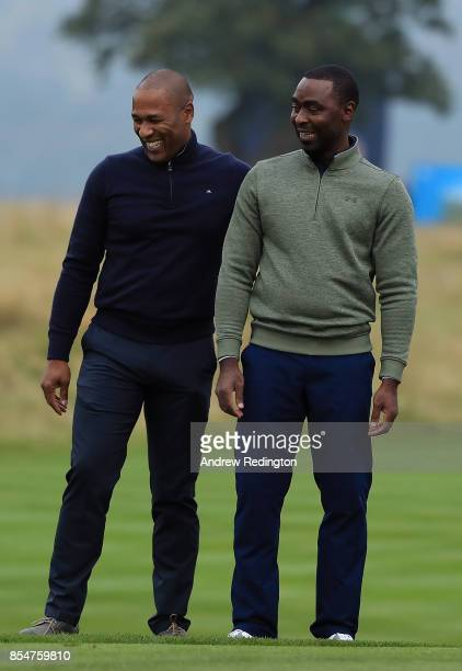 Former footballers Les Ferdinand and Andy Cole share a joke during the pro am ahead of the British Masters at Close House Golf Club on September 27...