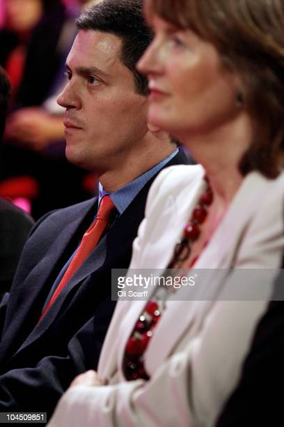 Former Foreign Secretary David Miliband and Labour deputy leader Harriet Harman listen to Labour party leader Ed Miliband's keynote speech to party...