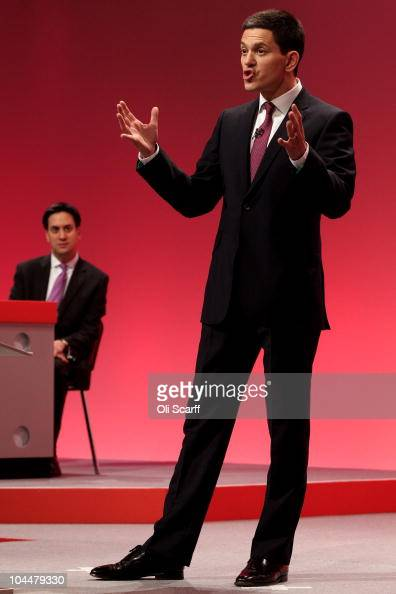 Former foreign secretary David Miliband delivers a keynote speech to delegates as his brother and party leader Ed Miliband listens on the second day...