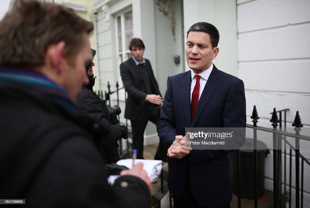Former Foreign Secretary <a gi-track='captionPersonalityLinkClicked' href=/galleries/search?phrase=David+Miliband&family=editorial&specificpeople=206702 ng-click='$event.stopPropagation()'>David Miliband</a> (R) talks to reporters at his home on March 27, 2013 in London, England. Mr Miliband, brother of the opposition Labour Party leader Ed Miliband, has announced that he is to step down as a Member of Parliament and will move to New York to work for the International Rescue Committee.