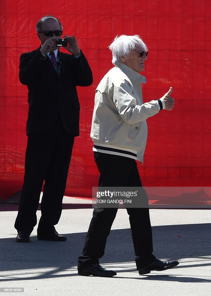 Former Formula 1 boss Bernie Ecclestone gives the thumbs up during the qualifying session at the Circuit de Catalunya on May 13, 2017 in Montmelo on the outskirts of Barcelona ahead of the Spanish Formula One Grand Prix. /