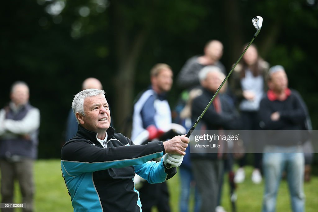 Former Formula 1 racing driver <a gi-track='captionPersonalityLinkClicked' href=/galleries/search?phrase=Derek+Warwick&family=editorial&specificpeople=662985 ng-click='$event.stopPropagation()'>Derek Warwick</a> hits an approach during the Pro-Am prior to the BMW PGA Championship at Wentworth on May 25, 2016 in Virginia Water, England.