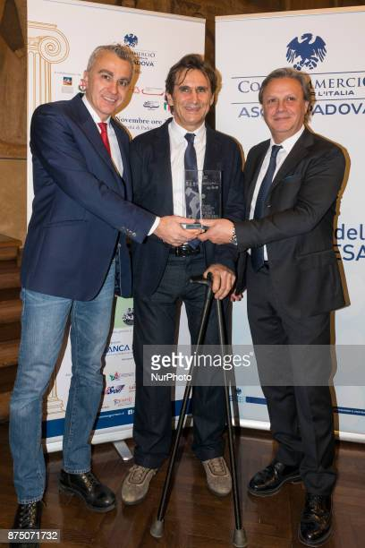 Former Formula One driver and paracyclist Alex Zanardi poses after he wins the 4th edition of sportliterature award 'Memo Geremia' at 'Palazzo Bo'...