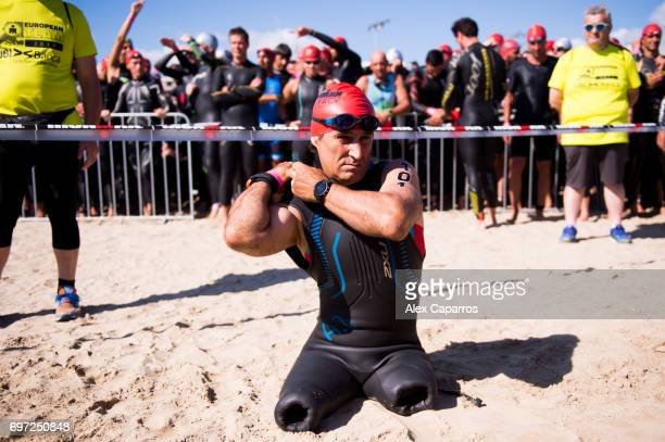 Former Formula One driver and paracyclist Alex Zanardi prepares to dive into the sea to start Ironman 703 Italy race on June 18 2017 in Pescara Italy