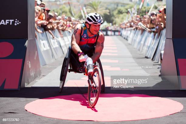 Former Formula One driver and paracyclist Alex Zanardi reacts as he finishes Ironman 703 Italy race on June 18 2017 in Pescara Italy