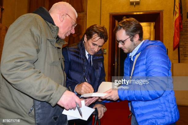 Former Formula One driver and paracyclist Alex Zanardi signs his book after he wins the 4th edition of sportliterature award 'Memo Geremia' at...