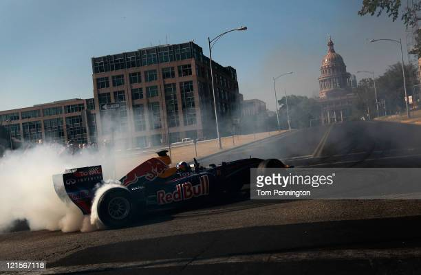 Former Formula One driver David Coulthard of Great Britain pilots the Red Bull Show Car in front of the Texas Capitol building on August 20 2011 in...