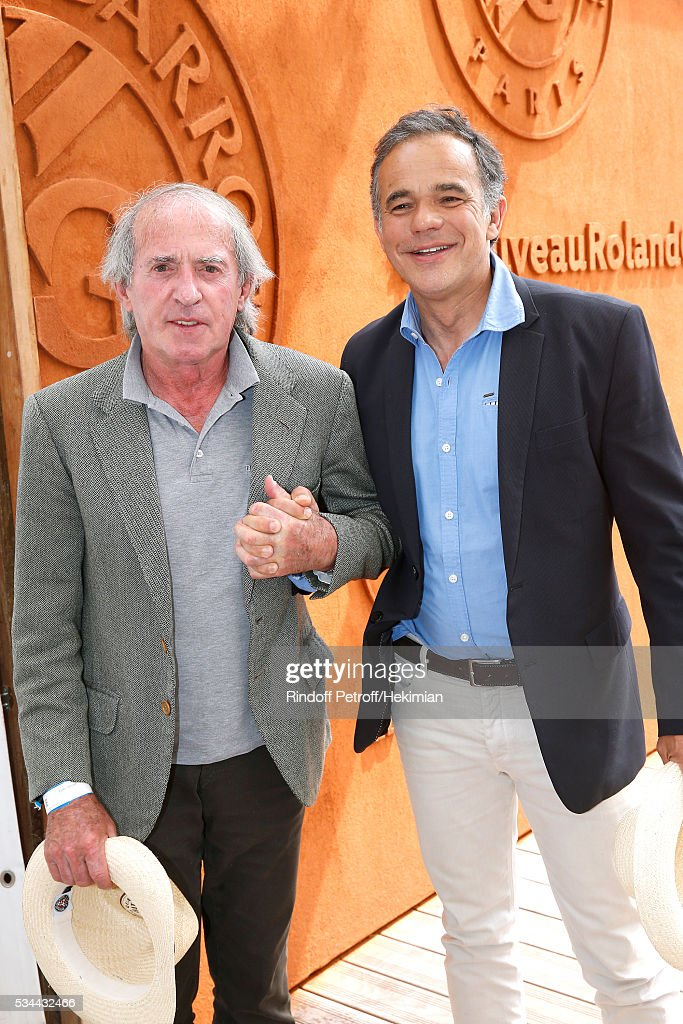 Former Formula One driver Jacques Laffite and motorcycle rider Philippe Monneret attend the 2016 French Tennis Open - Day Five at Roland Garros
