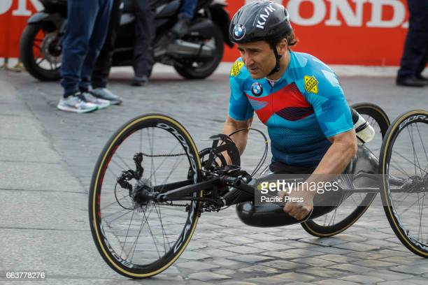 Former Formula One race car driver Alex Zanardi who lost both legs in a crash in 2001 runs the Men's Handcycle category of the 23rd edition of the...