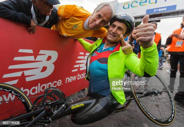 Former Formula One race car driver Alex Zanardi who lost both legs in a crash in 2001 and Giovanni Malagò attend the Men's Handcycle category of the...