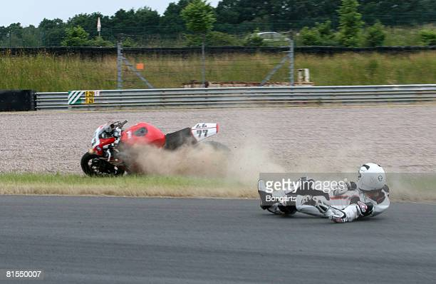Former Formula One world champion Michael Schumacher falls from his bike during a test ride of the Superbike International German Championship IDM at...