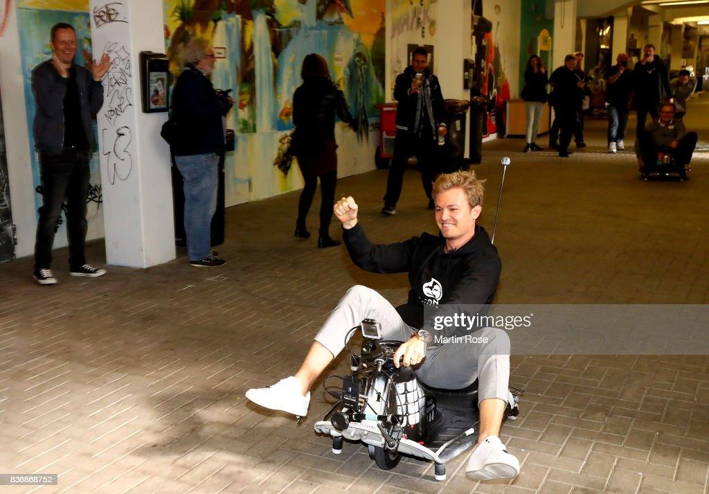 Former Formula One Worldchampion Nico Rosberg of Germany celebrates after winning the viva con aqua social e-cart race at Millerntor Stadium on August 22, 2017 in Hamburg, Germany.