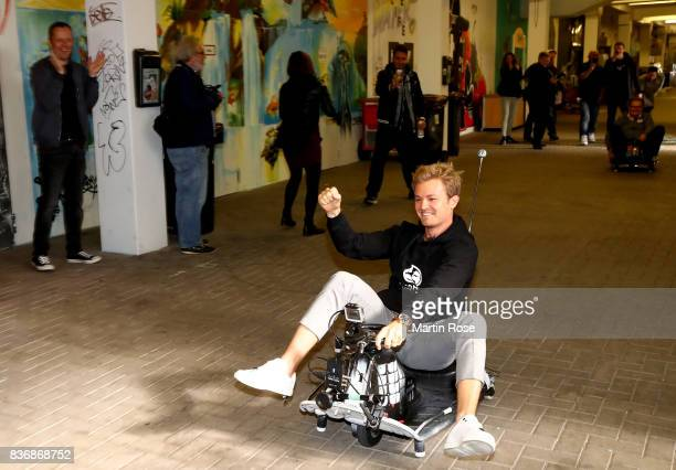 Former Formula One Worldchampion Nico Rosberg of Germany celebrates after winning the viva con aqua social ecart race at Millerntor Stadium on August...
