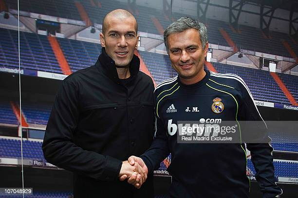 Former France and Real Madrid player Zinedine Zidane shakes hands with head coach Jose Mourinho at the Valdebebas training ground on November 21 2010...