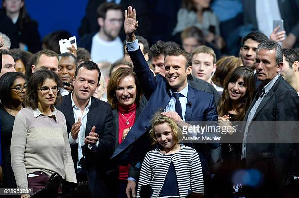 Former France Economy Minister Emmanuel Macron thanks his supporters as he arrives on stage for the central political party 'En Marche' meeting on...