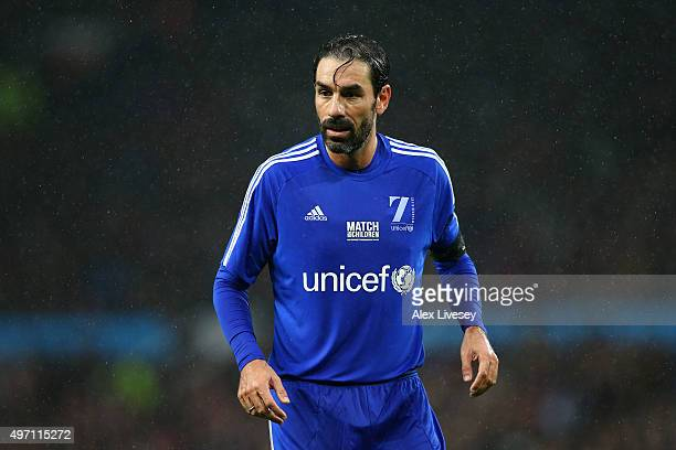 Former France player Robert Pires of the Rest of the World in action during the David Beckham Match for Children in aid of UNICEF between Great...