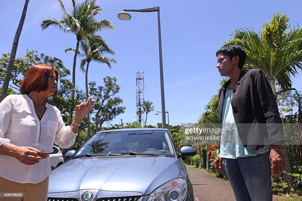 Former Francophonie minister Margie Sudre (L), speaks with newly appointed French minister of State for Real Equality, Ericka Bareigts outside of the Antenne Reunion tv group in Saint-Denis de la Reunion, on February 12, 2016. Bareigts was named Minister of State for Real Equality on February 11, 2016 as French President Francois Hollande reshuffled his cabinet, naming Jean-Marc Ayrault foreign minister and adding several ecologists to government as he seeks to widen his political base ahead of a presidential poll in 2017. / AFP / RICHARD BOUHET