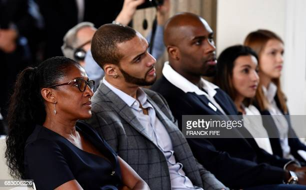 Former French athlete MarieJose Perec Utah Jazz's French centre Rudy Gobert and French Olympic Judo champion Teddy Riner listen to the speech of the...
