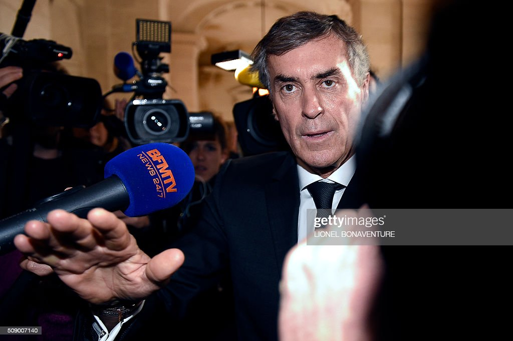 Former French budget minister Jerome Cahuzac gestures as he arrives on the first day of his trial for tax fraud at the courthouse of Paris, on February 8, 2016. Cahuzac, 63, who resigned in disgrace in 2013 after admitting to having a secret Swiss bank account, faces up to seven years in jail and two million euros (USD 2.2 million) in fines if found guilty of stashing offshore his earnings from a lucrative hair-transplant business he ran with his now ex-wife. AFP PHOTO / LIONEL BONAVENTURE / AFP / LIONEL BONAVENTURE