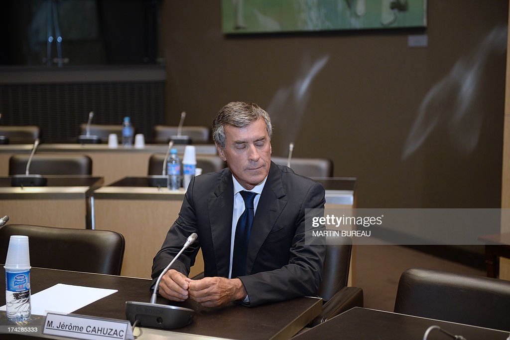 Former French Budget Minister Jerome Cahuzac, who resigned from the government in disgrace over an undeclared Swiss bank account, waits prior to a hearing before a parliamentary probe committee at the French national assembly on July 23, 2013 in Paris. AFP PHOTO / MARTIN BUREAU
