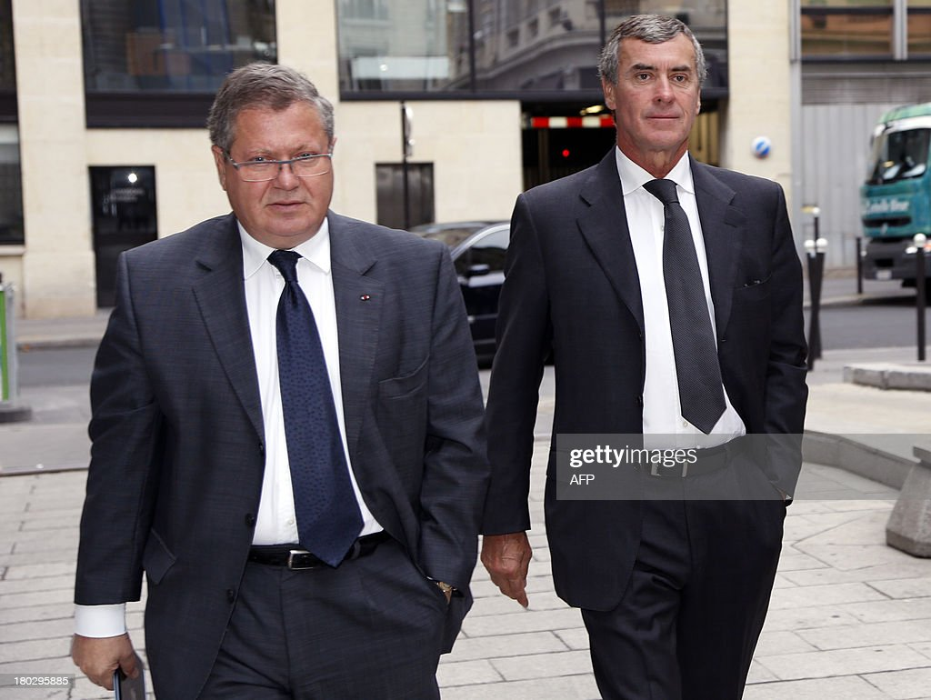 Former French Budget Minister Jerome Cahuzac (R) who resigned from the government in disgrace over an undeclared Swiss bank account, flanked by his lawyer Jean Veil, arrives at the financial pole in Paris, on September 11, 2013. AFP PHOTO / THOMAS SAMSON