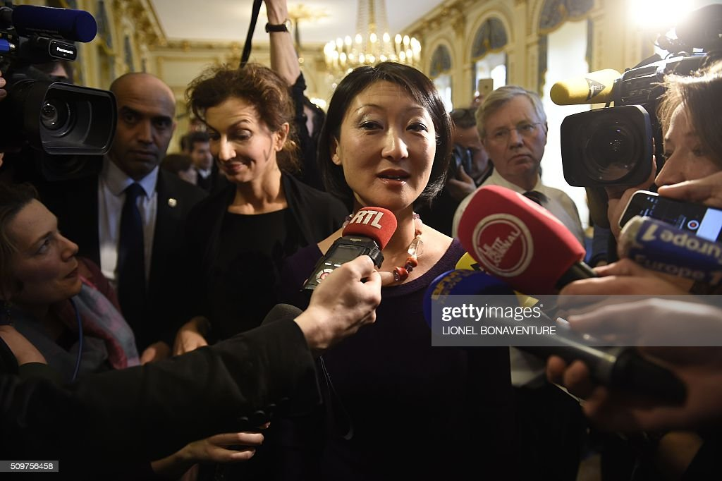 Former French Culture minister Fleur Pellerin speaks to journalists on February 12, 2016 in Paris as Audrey Azoulay, named new French Culture minister listens during the transferal of powers. Audrey Azoulay was named new French Culture minister as French President Francois Hollande reshuffled his cabinet on February 11, 2016, naming Jean-Marc Ayrault foreign minister and adding several ecologists to government as he seeks to widen his political base ahead of a presidential poll in 2017. AFP PHOTO / LIONEL BONAVENTURE / AFP / LIONEL BONAVENTURE