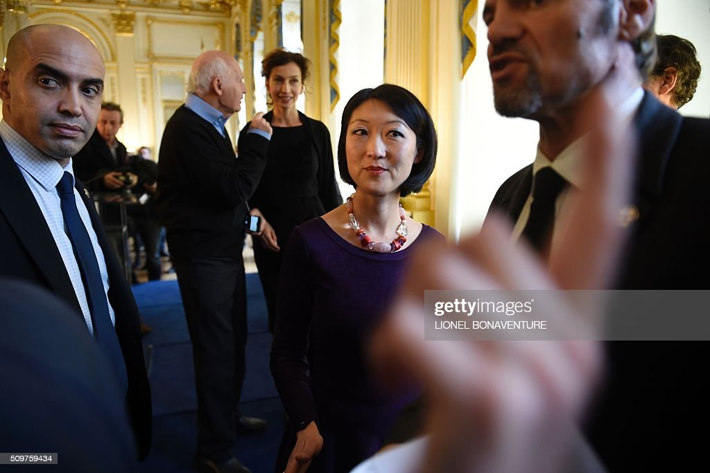 Former French Culture minister Fleur Pellerin walks on February 12, 2016 in Paris during the transferal of powers to Audrey Azoulay (background), named new French Culture minister. Audrey Azoulay was named new French Culture minister as French President Francois Hollande reshuffled his cabinet on February 11, 2016, naming Jean-Marc Ayrault foreign minister and adding several ecologists to government as he seeks to widen his political base ahead of a presidential poll in 2017. AFP PHOTO / LIONEL BONAVENTURE / AFP / LIONEL BONAVENTURE