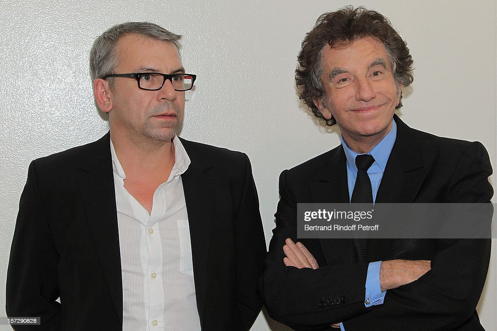 Former French Culture Minister Jack Lang (R) and actor Philippe Torreton pose in French impersonator Laurent Gerra's dressing room following his One Man Show at Palais des Congres on November 28, 2012 in Paris, France.