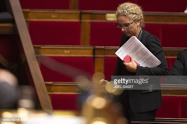 Former French Ecology Minister Delphine Batho walks on September 24 2014 at the parliament during a debate without a vote over France's engagement in...