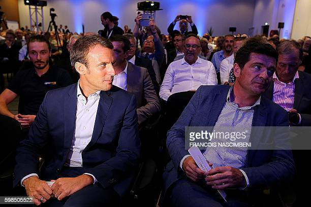 Former French Economy and Industry minister Emmanuel Macron and French rightwing Les Republicains party member of parliament Benoist Apparu attend a...